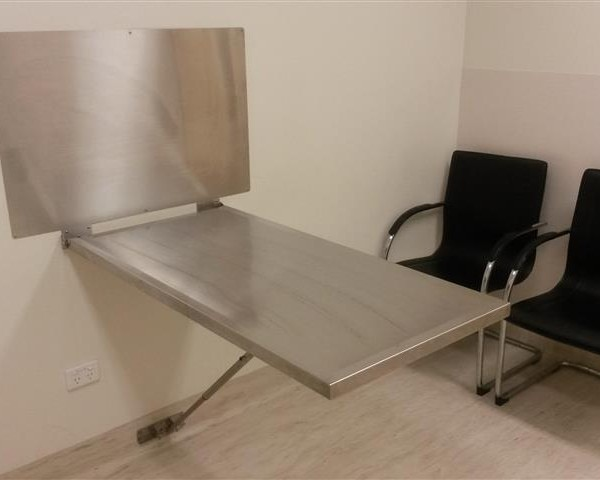 folding wall mount exam table